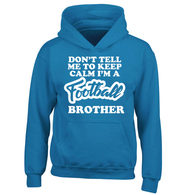 Don't tell me to keep calm I'm a football brother children's blue hoodie 12-14 Years