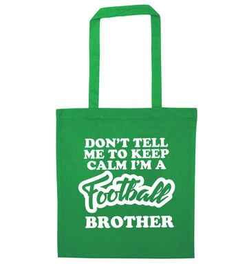 Don't tell me to keep calm I'm a football brother green tote bag