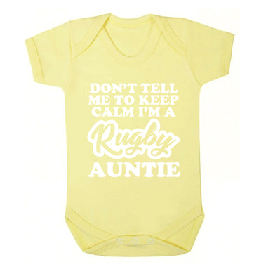 Don't tell me keep calm I'm a rugby auntie Baby Vest pale yellow 18-24 months
