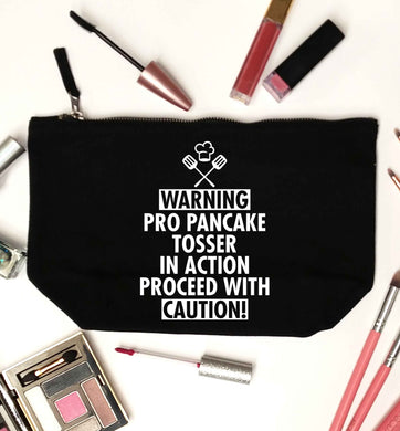 Warning pro pancake tosser in action proceed with caution black makeup bag