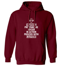 Warning pro pancake tosser in action proceed with caution adults unisex maroon hoodie 2XL