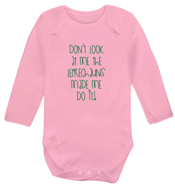 Don't look at me the leprechauns made me do it baby vest long sleeved pale pink 6-12 months