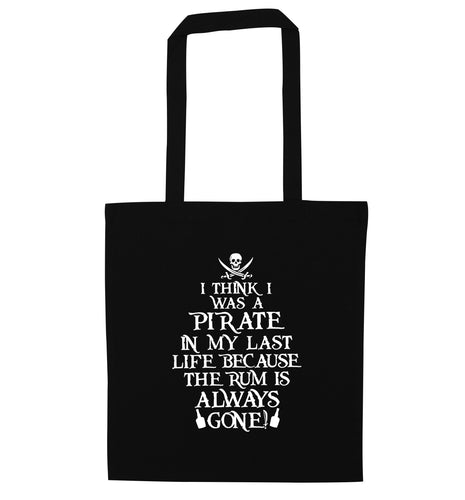 I think I was a pirate in my past life because the rum is always gone! black tote bag
