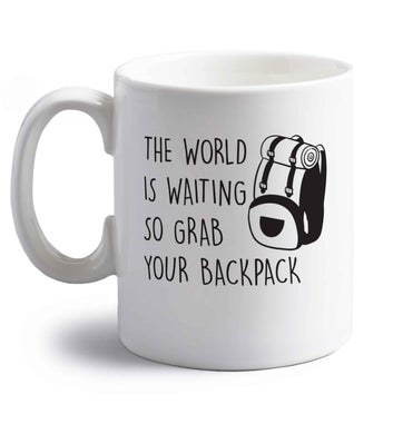 The world is waiting so grab your backpack right handed white ceramic mug