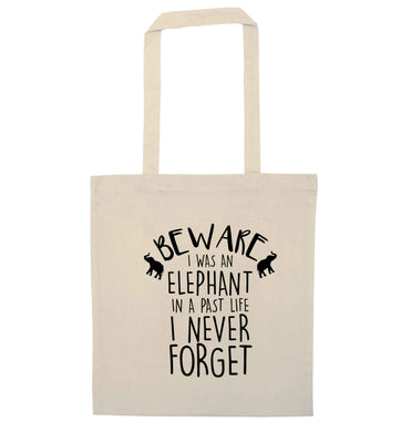 Beware I was an elephant in my past life I never forget natural tote bag