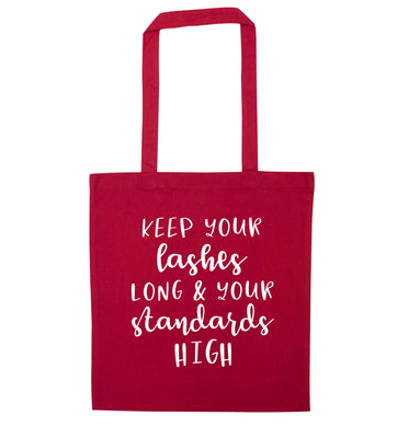 Keep your lashes long and your standards high red tote bag