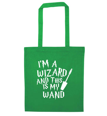 I'm a wizard and this is my wand green tote bag