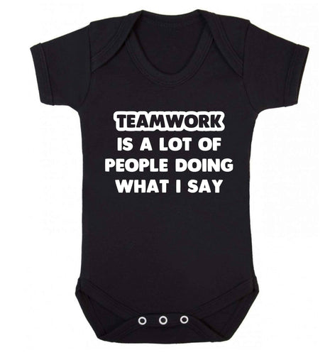 Teamwork is a lot of people doing what I say Baby Vest black 18-24 months
