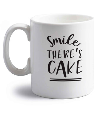 Smile there's cake right handed white ceramic mug