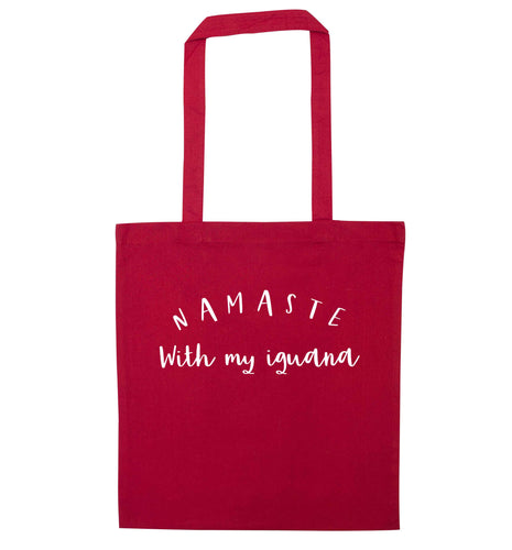 Namaste with my iguana red tote bag