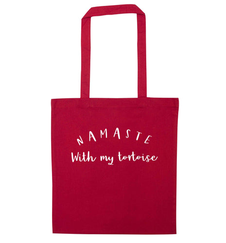 Namaste with my tortoise red tote bag