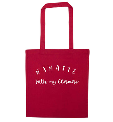Namaste with my llamas red tote bag