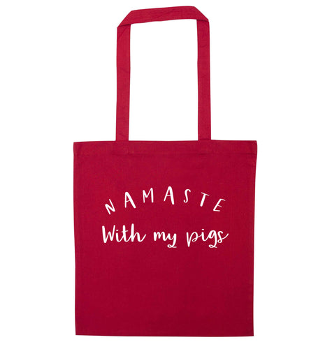 Namaste with my pigs red tote bag