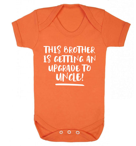 This brother is getting an upgrade to uncle! Baby Vest orange 18-24 months