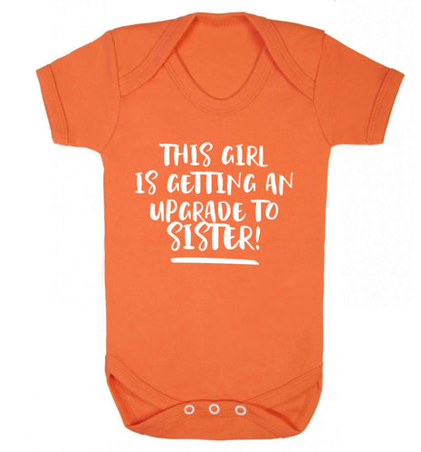 This girl is getting an upgrade to sister! Baby Vest orange 18-24 months