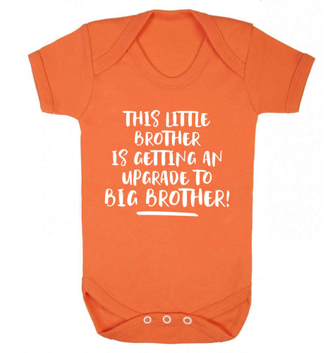 This little brother is getting an upgrade to big brother! Baby Vest orange 18-24 months