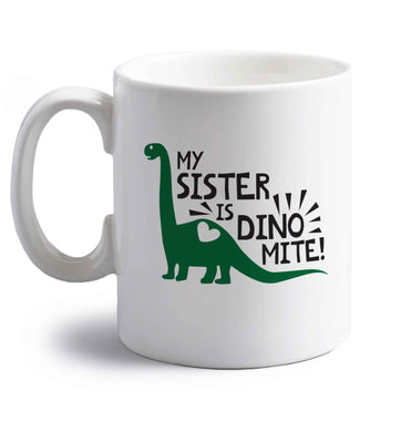 My sister is dinomite! right handed white ceramic mug