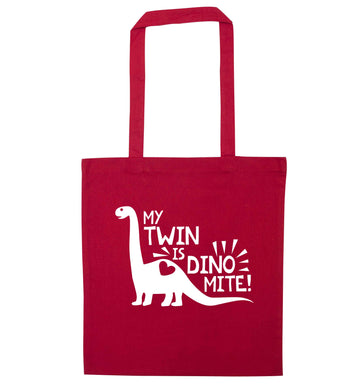 My twin is dinomite! red tote bag