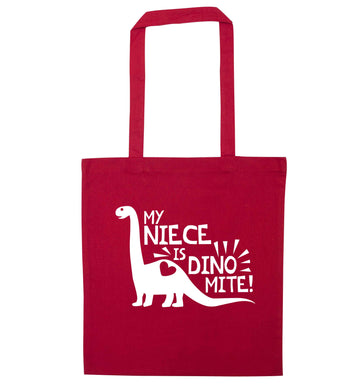 My niece is dinomite! red tote bag