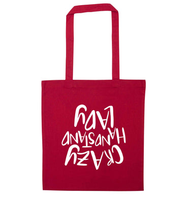 Crazy handstand lady red tote bag