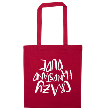 Crazy handstand dude red tote bag