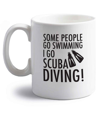 Some people go swimming I go scuba diving! right handed white ceramic mug