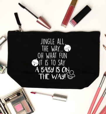 Oh what fun it is to say a baby is on the way! black makeup bag