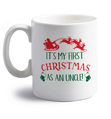 It's my first Christmas as an uncle! right handed white ceramic mug