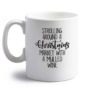 Strolling around a Christmas market with mulled wine right handed white ceramic mug