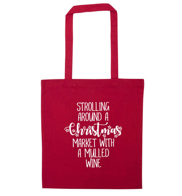 Strolling around a Christmas market with mulled wine red tote bag