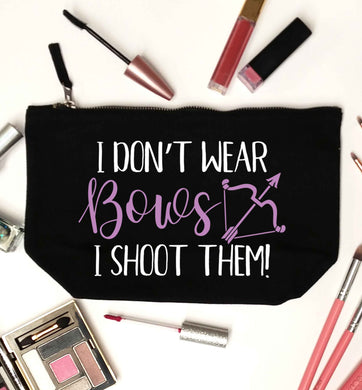 I don't wear bows I shoot them black makeup bag