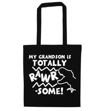 My grandson is totally rawrsome black tote bag