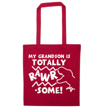 My grandson is totally rawrsome red tote bag