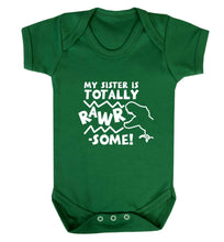 My sister is totally rawrsome baby vest green 18-24 months