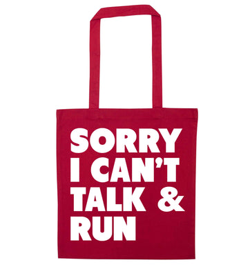 Sorry I can't talk and run red tote bag