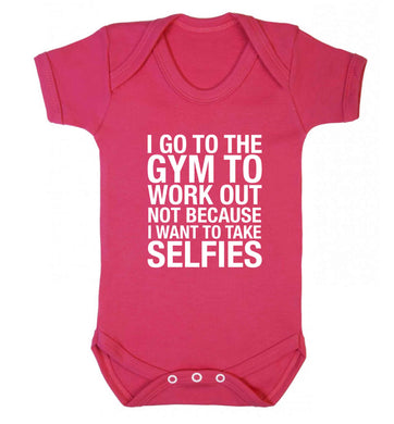 I go to the gym to workout not to take selfies baby vest dark pink 18-24 months