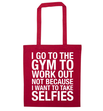 I go to the gym to workout not to take selfies red tote bag