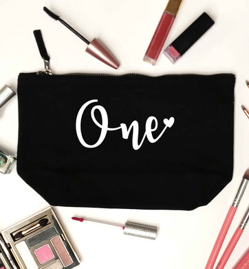 One black makeup bag