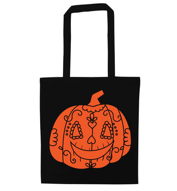 Pumpkin sugar skull black tote bag