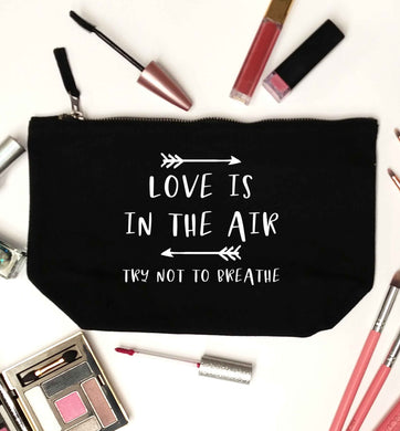 Love is in the air try not to breathe black makeup bag