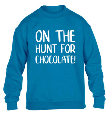 On the hunt for chocolate! children's blue sweater 12-13 Years