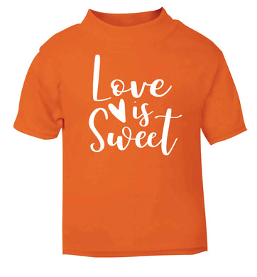 Love really does make the world go round! Ideal for weddings, valentines or just simply to show someone you love them!  orange baby toddler Tshirt 2 Years