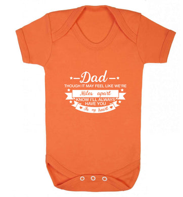 Dad though it may feel like we're miles apart know I'll always have you in my heart baby vest orange 18-24 months