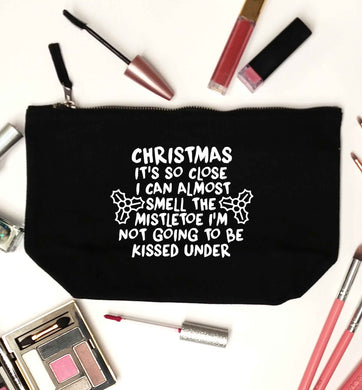 Christmas it's so close I can almost smell the misteltoe I'm not going to be kissed under black makeup bag