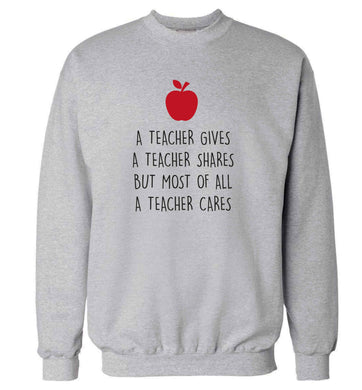 A teacher gives a teacher shares but most of all a teacher cares adult's unisex grey sweater 2XL
