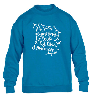 It's beginning to look a lot like Christmas children's blue sweater 12-13 Years