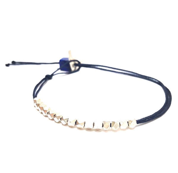 Boomerang hunting bracelet with polyhedrons