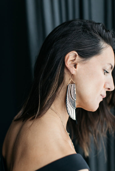 Hanna wears Deco Wing earrings by Rosita Bonita