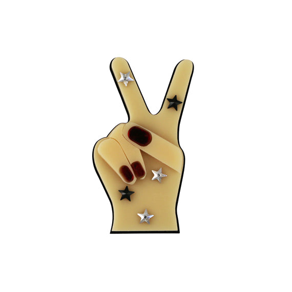 Peace Out brooch by Jennifer Loiselle - available at collectiveboutique.co.uk