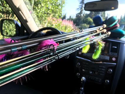 Fly rods and reels loaded in car.